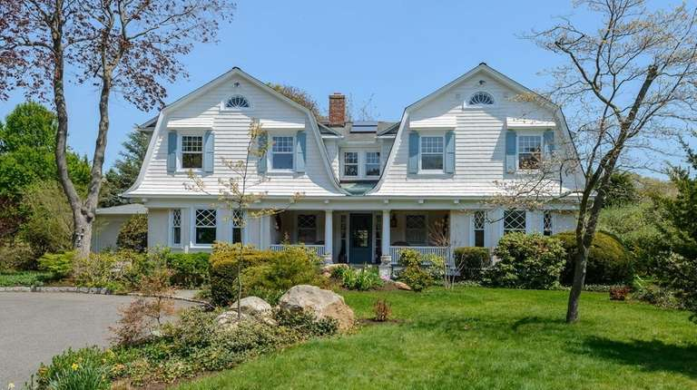 Once a gardener's cottage, this five-bedroom Dutch Colonial