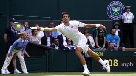 Novak Djokovic of Serbia plays a return to