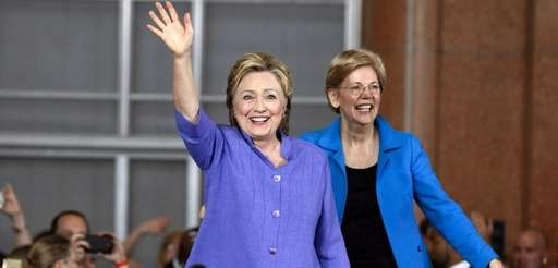 Hillary Clinton, left, and Sen. Elizabeth Warren wave