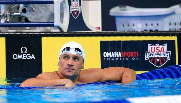 Ryan Lochte checks the clock after swimming in
