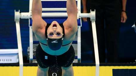 Missy Franklin dives at the start of a