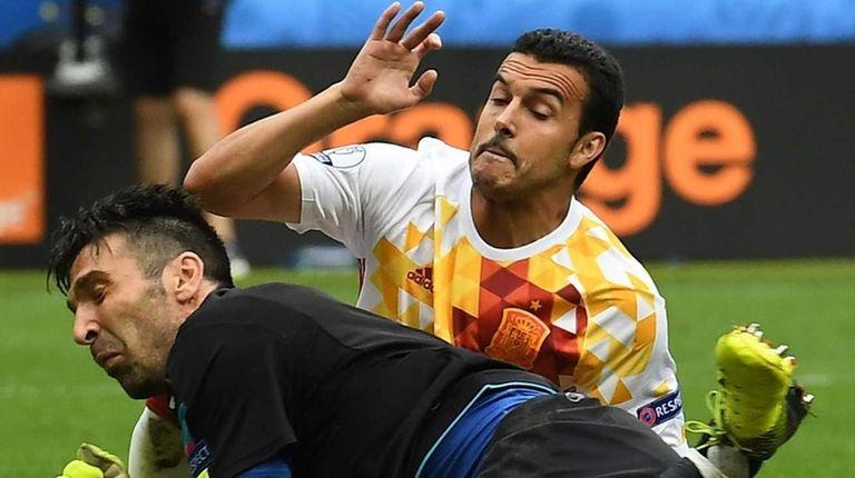 Pedro of Spain in action against goalkeeper Gianluigi
