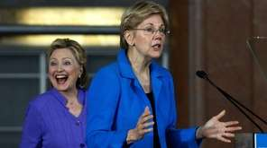 Hillary Clinton grins as Sen Elizabeth Warren speaks