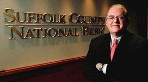 Suffolk Bancorp chief executive Howard Bluver at his