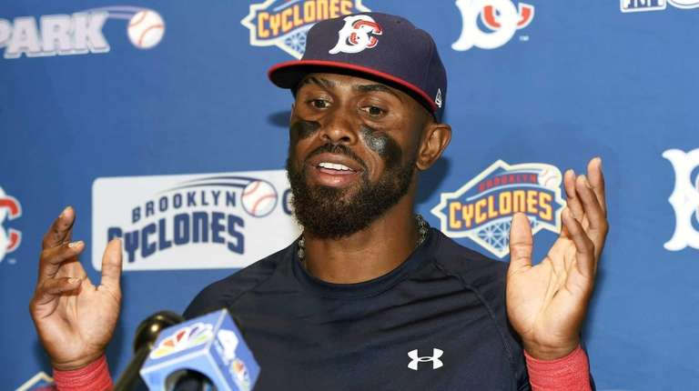 New York Mets' Jose Reyes answers questions from