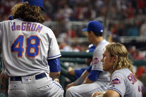 New York Mets pitcher Jacob deGrom talks with
