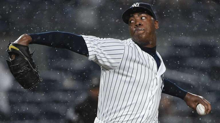 New York Yankees relief pitcher Aroldis Chapman delivers