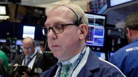 Trader Richard Cohen works on the floor of