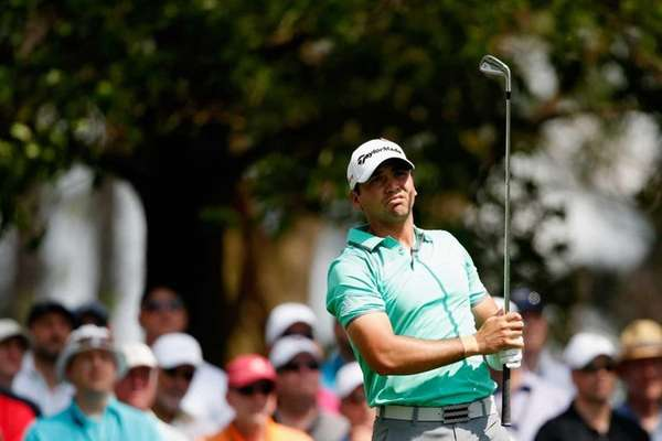 Jason Day hits a shot on the fourth
