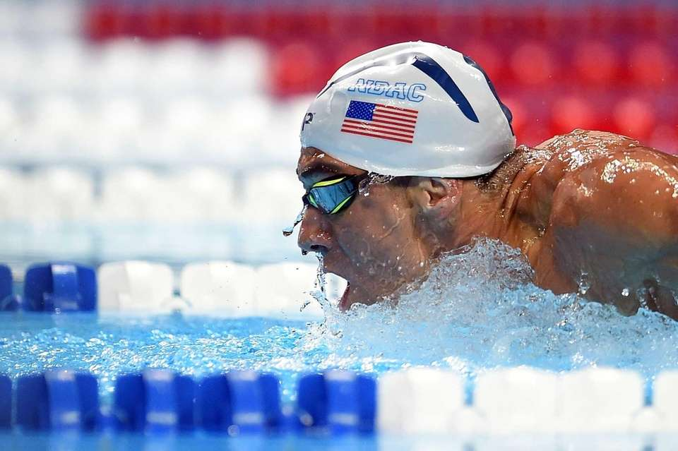 Michael Phelps of the United States competes in