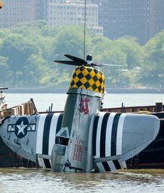 A vintage World War II plane is pulled