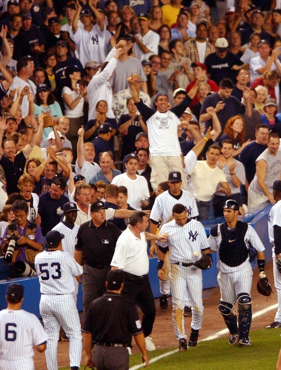 New York Yankees' Derek Jeter is escorted off