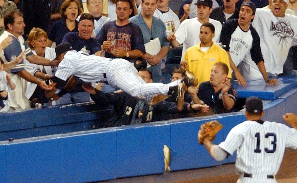 New York Yankees' Derek Jeter dives to catch