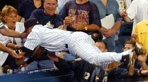 New York Yankees' Derek Jeter dives to catch