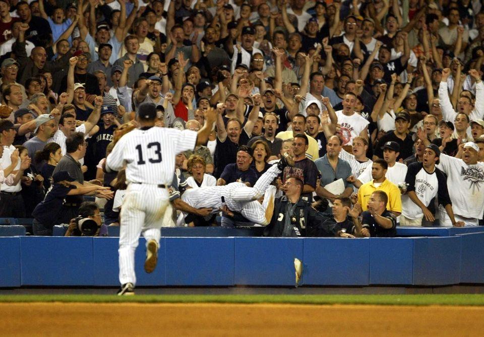 Fans react as New York Yankees shortstop Derek