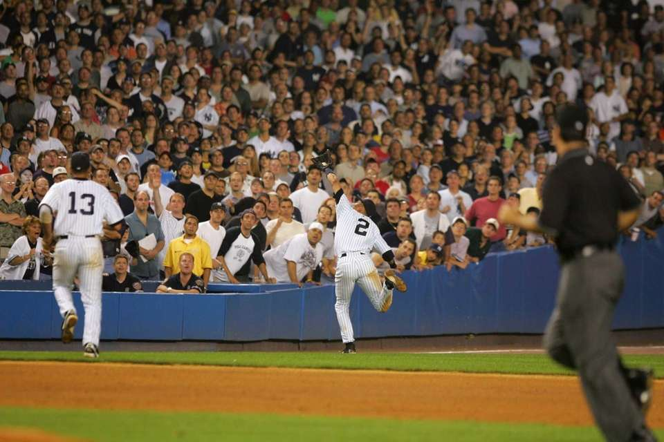 Derek Jeter of the New York Yankees catches