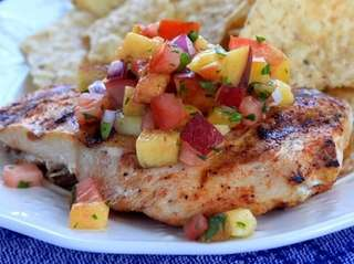 Grilled boneless chicken breasts seasoned with cumin and
