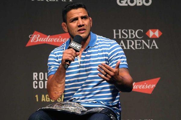 Lightweight Champion Rafael dos Anjos of Brazil interacts