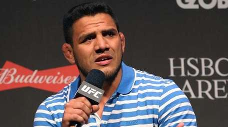 Lightweight Champion Rafael dos Anjos of Brazil interacts