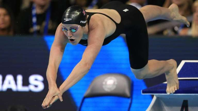 Missy Franklin dives at the start of her