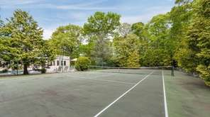 The four-bedroom house in Northport has a regulation-size