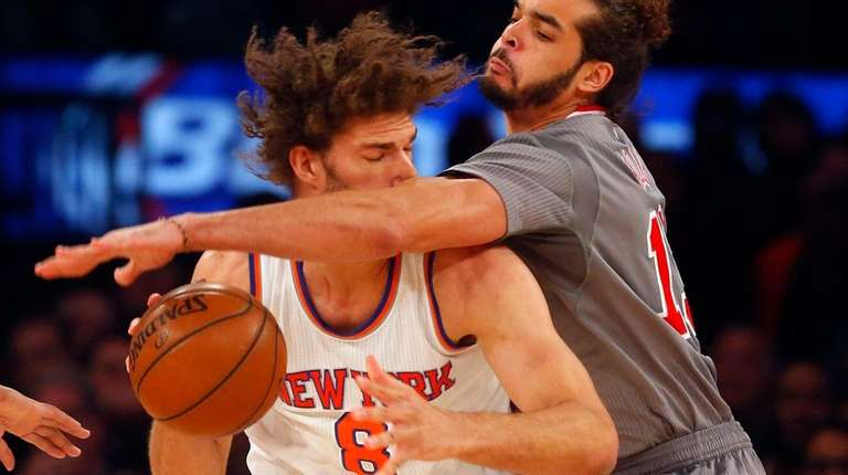 Joakim Noah #13 of the Chicago Bulls defends