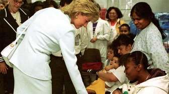 Princess Diana greets patients and visitors while touring