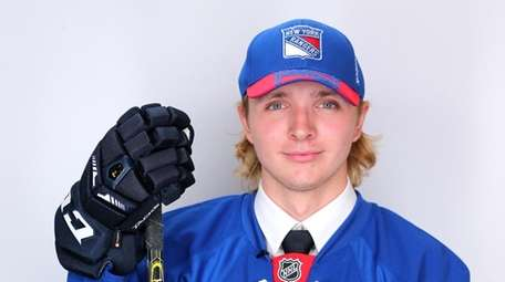Robin Kovacs poses after being selected 62nd overall