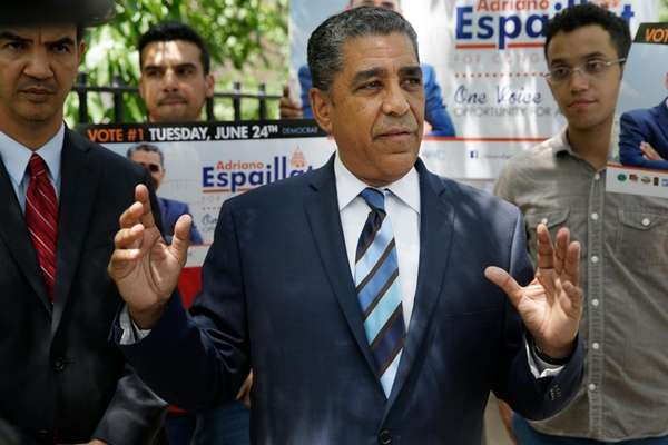 Congressional Demcratic candidate Adriano Espaillat speaks with reporters