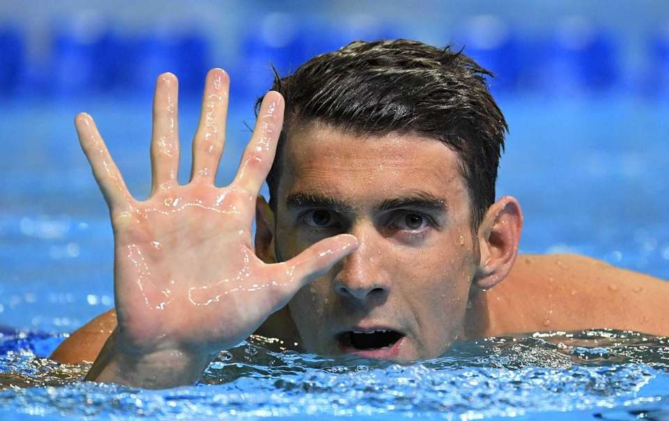 Michael Phelps gestures after winning the men's 200-meter