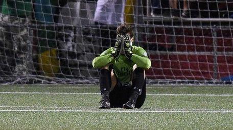 New York Cosmos goalkeeper Jimmy Maurer reacts after