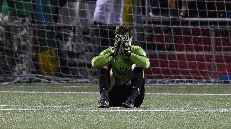 New York Cosmos goalkeeper Jimmy Maurer reacts after