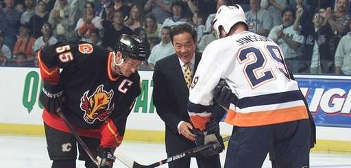 Charles Wang is all smiles during ceremonial face-off