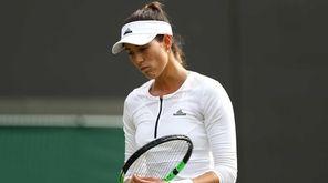 Garbine Mugaruza of Spain looks on following defeat