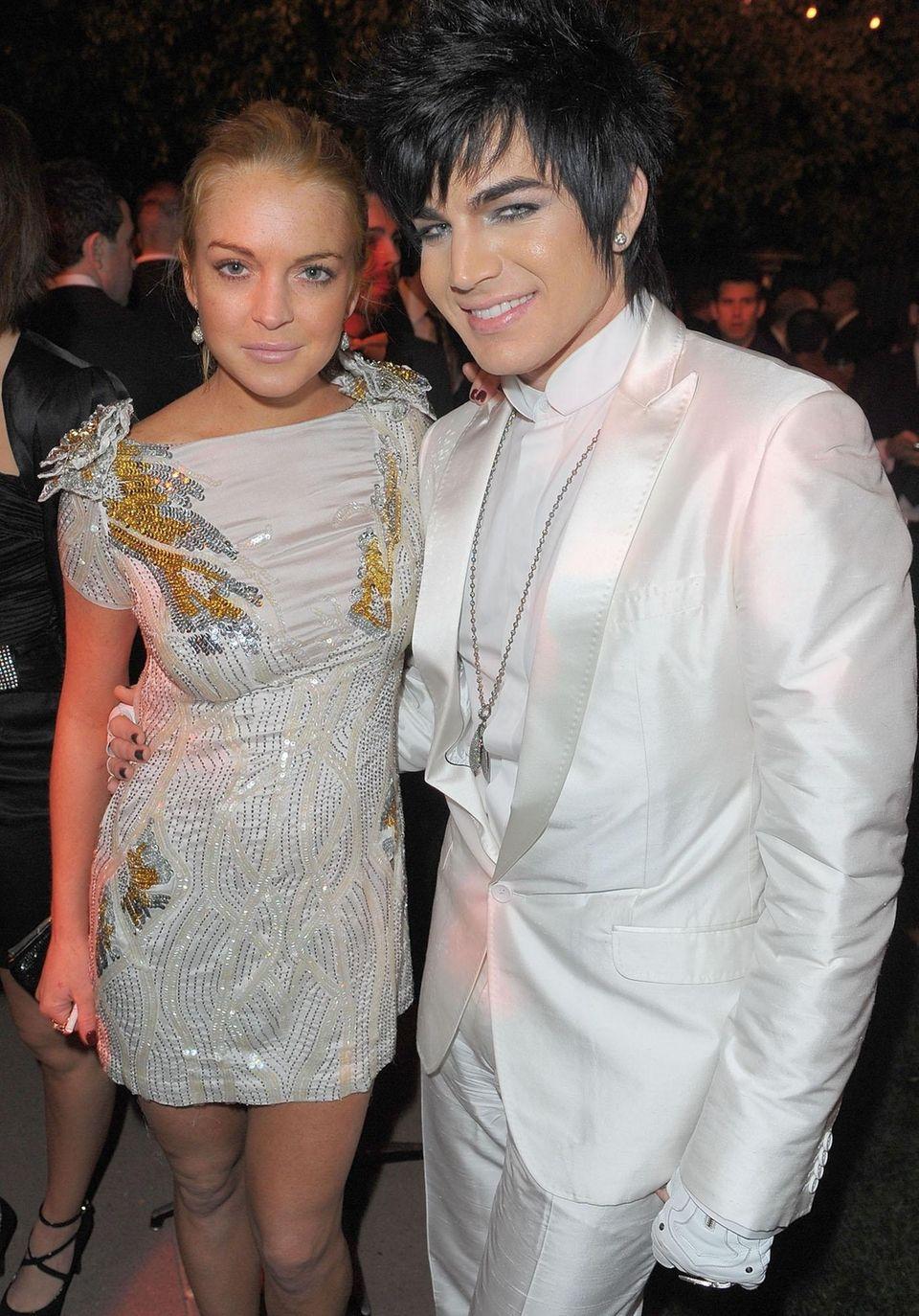 Lindsay Lohan and singer Adam Lambert attend The