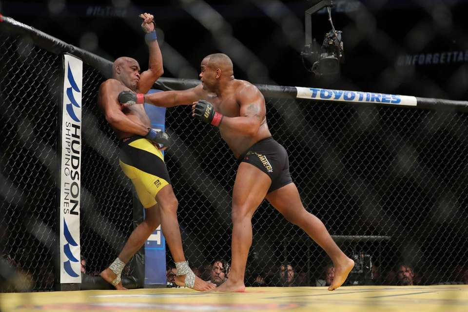 UFC light heavyweight champion Daniel Cormier, right, was