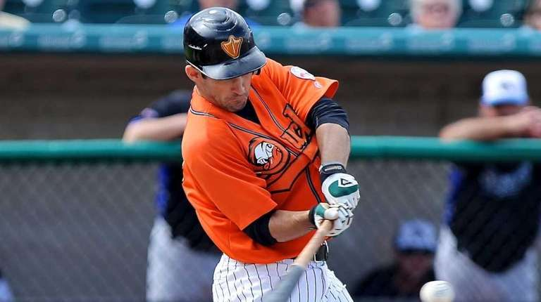 Long Island Ducks' Dan Lyons drives a single