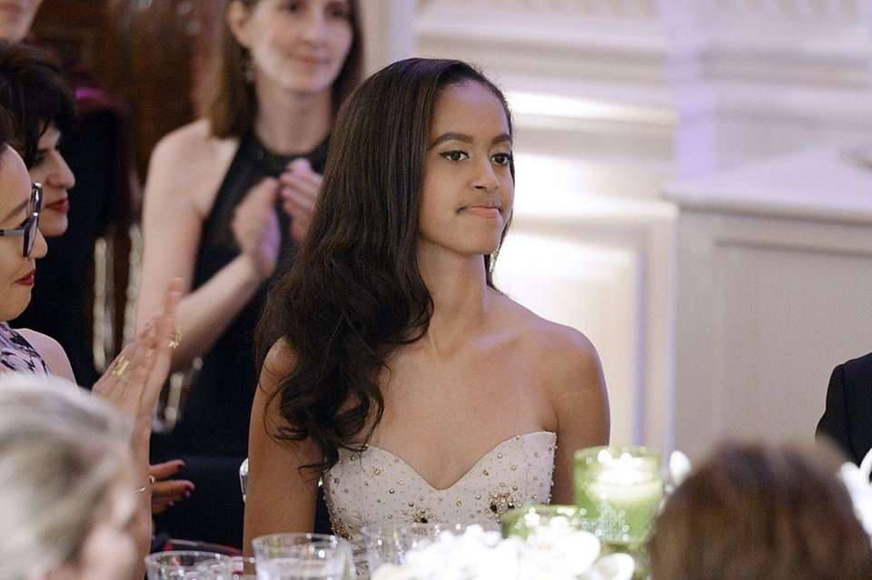 President Barack Obama and Michelle Obama's elder daughter,