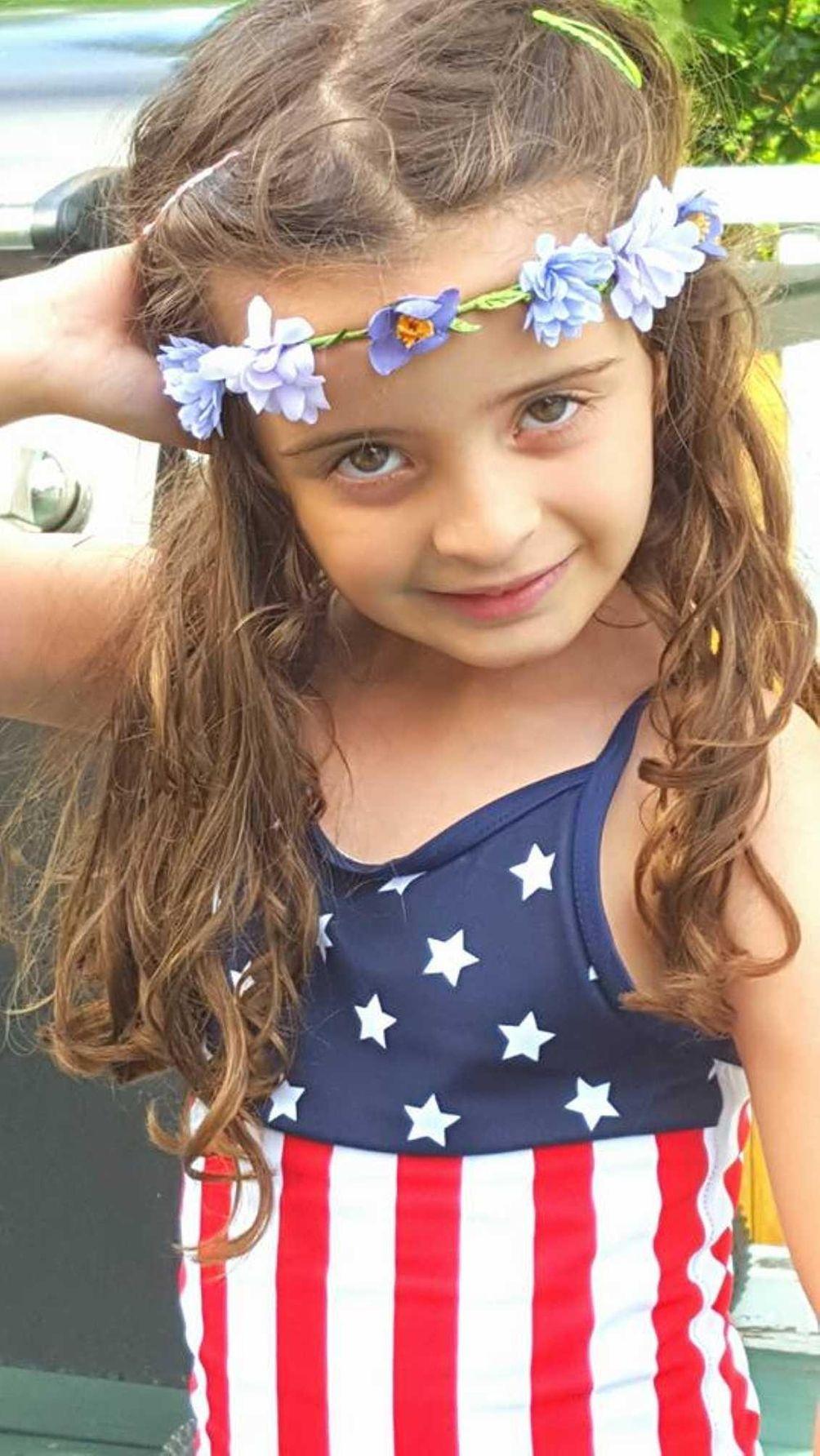 Emma wearing her Stars and Stripes, enjoying 4th