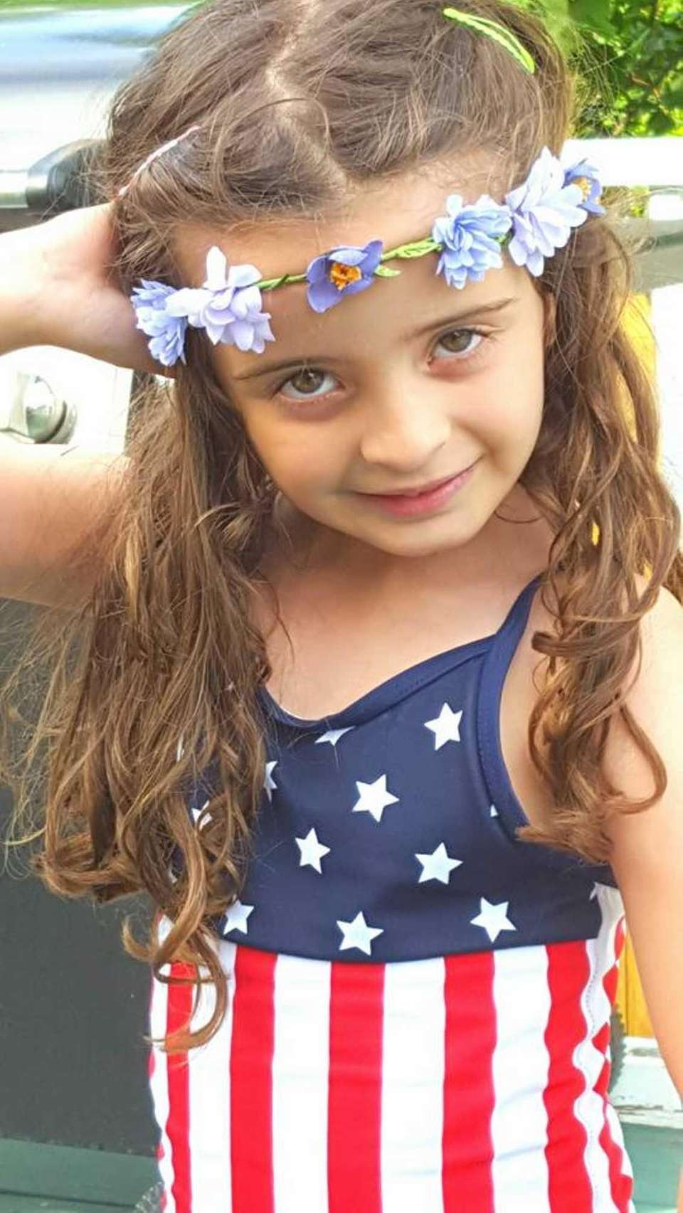 Emma wearing her Stars and Stripes, enjoying 4th
