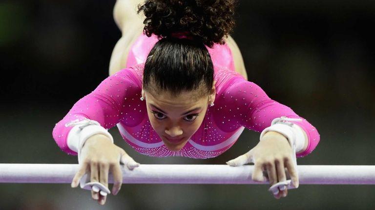 Lauren Hernandez warms up on the uneven bars