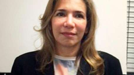 Wafa Abboud, 48, of Merrick, the former CEO