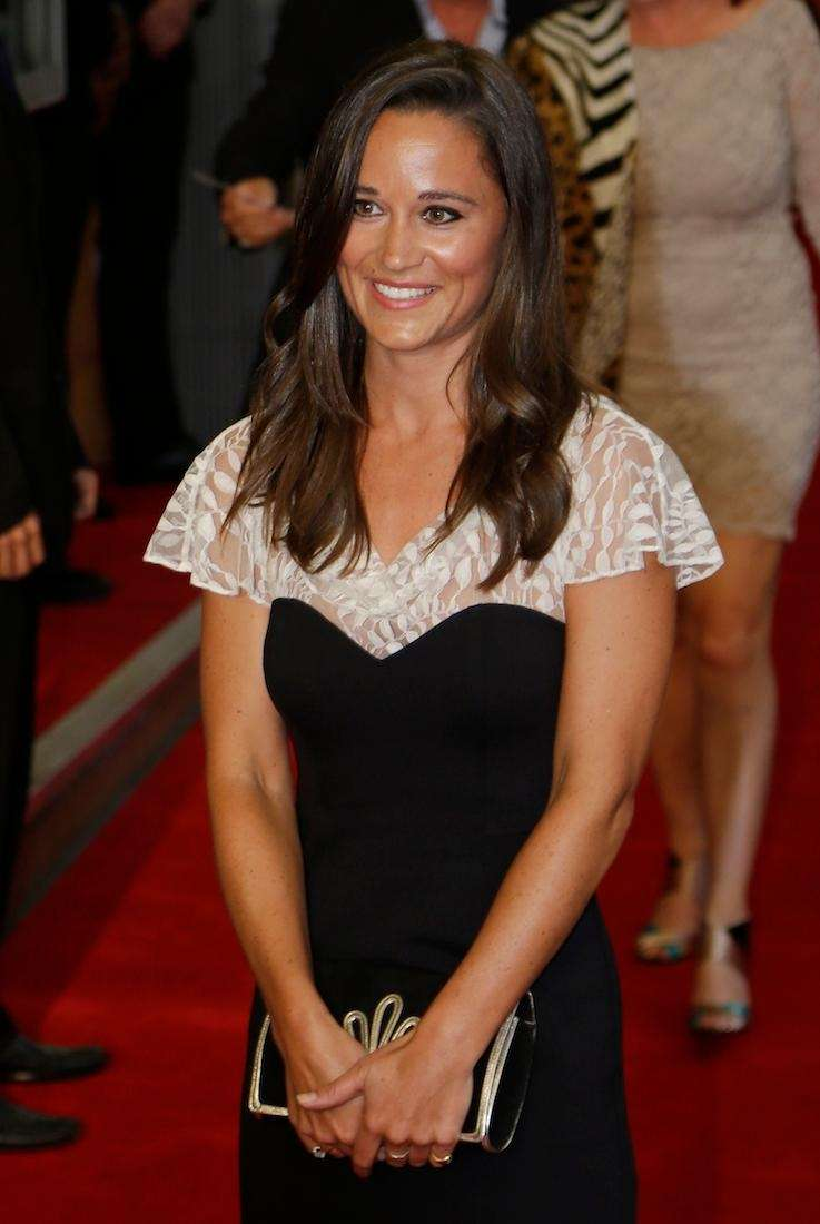 Pippa Middleton poses for photographers as she attends