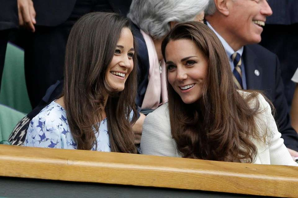 From left, Pippa Middleton and Kate Middleton watch
