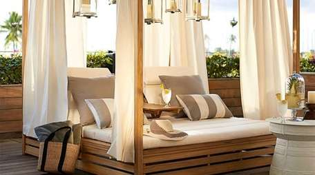 The Madera Teak Daybed ($4,499 at potterybarn.com) comes