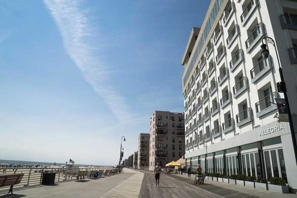 The Long Beach boardwalk runs behind the Allegria