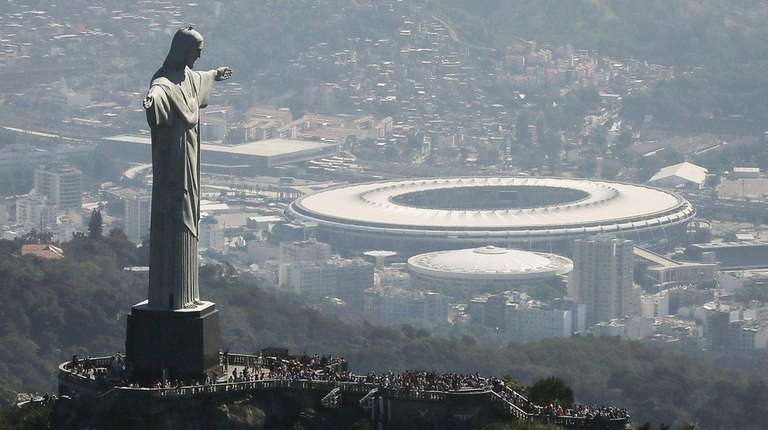 Visitors gather beneath the Christ the Redeemer statue