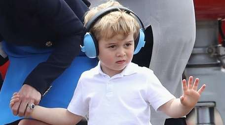 Prince George waves during a visit to the
