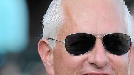 Trainer Todd A. Pletcher heads to the winner's