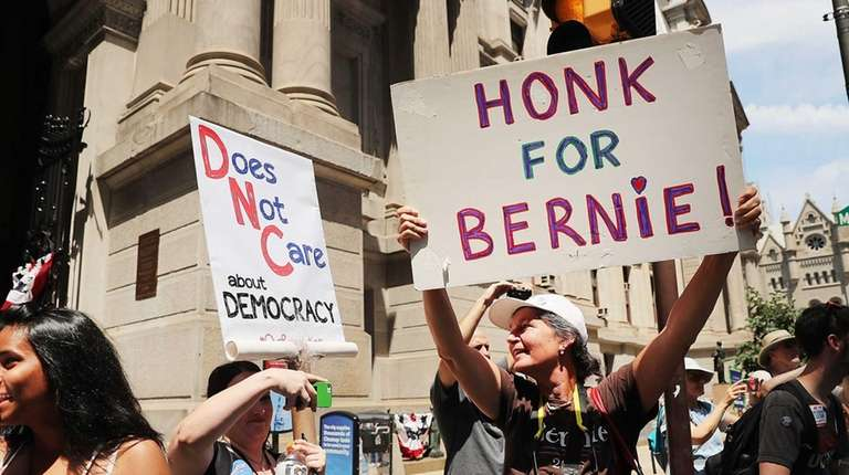 Bernie Sanders supporters gather for a march before